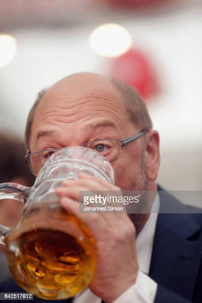Martin Schulz chancellor candidate of the German Social Democrats sips a beer in a fest tent at the Gillamoos amusement fair on September 4 2017 in...
