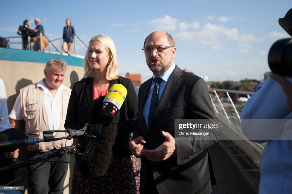 Martin Schulz, chancellor candidate of the German Social Democrats (SPD) and Governor of Mecklenburg-Western Pomerania Manuela Schwesig, are seen speaking to the press at the Ozeanum (aquarium) in the German city of Stralsund, during an election campaign stop on August 16, 2017 in Stralsund, Germany. Germany is scheduled to hold federal elections on September 24 and Schulz is currently approximately 14 points behind his rival, German Christian Democrat (CDU) and current German Chancellor Angela Merkel, who is seeking a fourth term as chancellor.