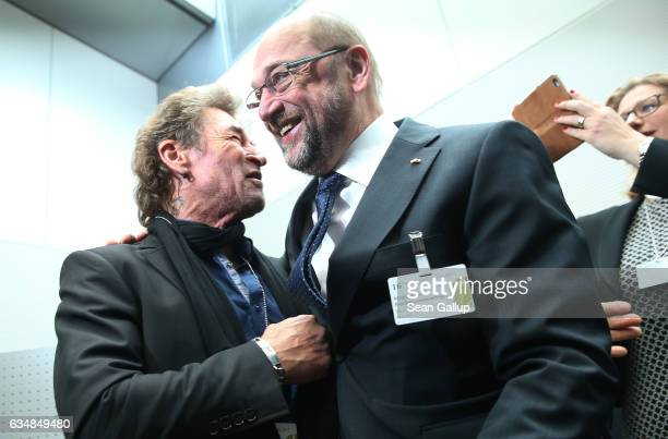 Martin Schulz chancellor candidate of the German Social Democrats in German federal elections scheduled for September chats with German rock singer...