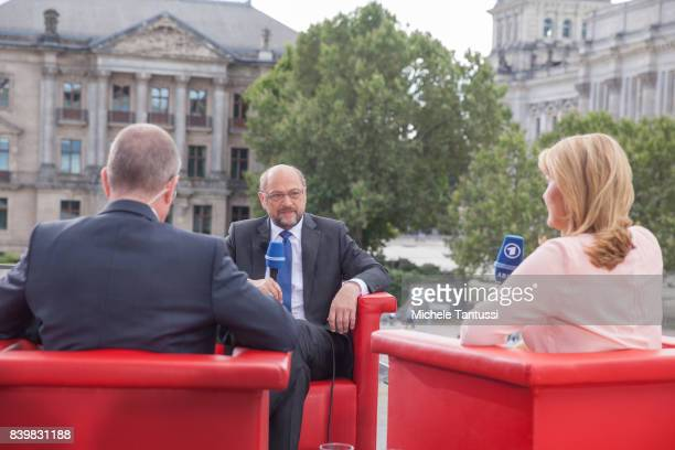 Martin Schulz chancellor candidate of the German Social Democrats speaks with Tina Hassel and Thomas Baumann during the ARD television studio for an...