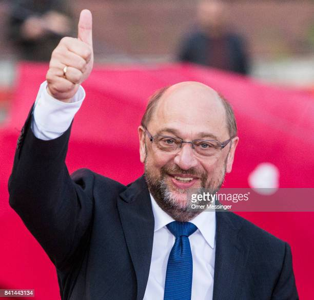"""Martin Schulz, chancellor candidate of the German Social Democrats , gestures to voters at a """"Martin Schulz live"""" election campaign stop on August..."""