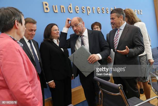 Martin Schulz head of the German Social Democrats and SPD chancellor candidate scartches his head as he is flanked by leading members of his party...