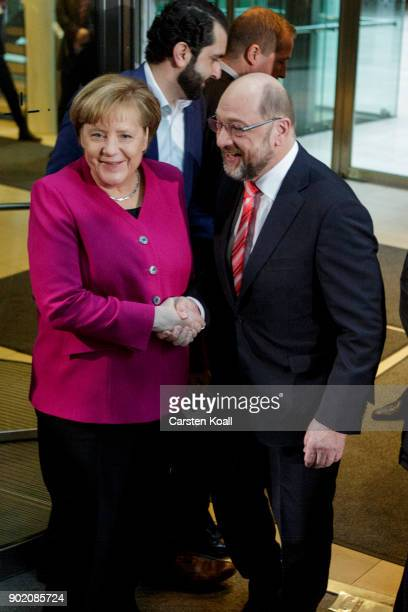 Martin Schulz head of the German Social Democrats welcomes German Chancellor and head of the German Christian Democratic Union Angela Merkel after...