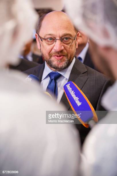 Martin Schulz, lead chancellor candidate of the German Social Democrats , speaks to journalists as he visits the Meergold fish smokehouse while...