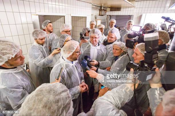 Martin Schulz lead chancellor candidate of the German Social Democrats speaks to journalists as he visits the Meergold fish smokehouse while...