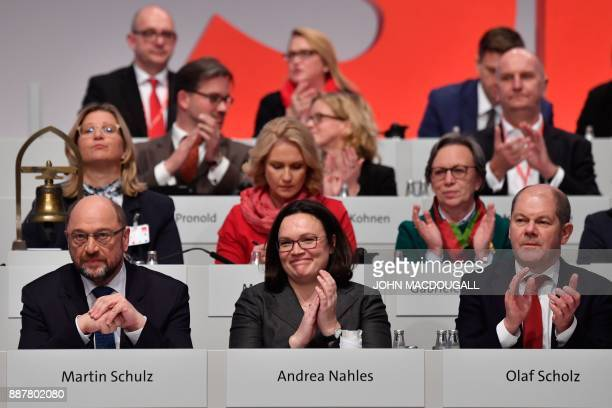 Martin Schulz leader of Germany's social democrat SPD party looks on as SPD board members applaud after Schulz was reelected as party leader during...