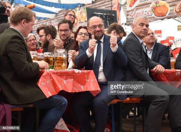 Martin Schulz leader of Germany's social democratic SPD party and candidate for Chancellor gives his thumbs up as he attends the 'Gillamoos'...