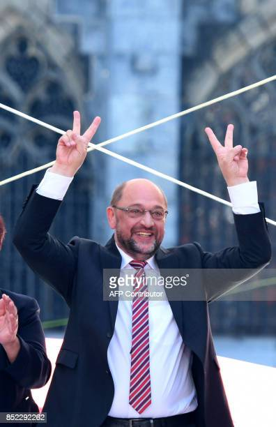Martin Schulz leader of Germany's social democratic SPD party and candidate for Chancellor makes the victory sign during an electoral meeting on the...