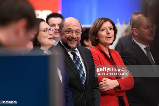 Martin Schulz leader of Germany's social democratic SPD party and leadership members stand together after delegates voted to begin formal coalition...