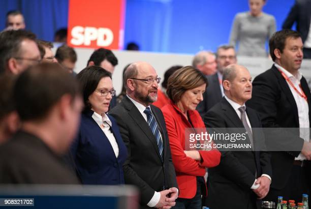Martin Schulz leader of Germany's social democratic SPD party and leadership members sing after delegates voted to begin formal coalition talks...