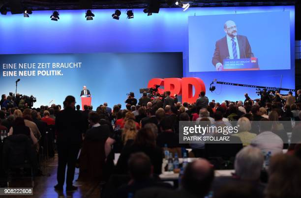 Martin Schulz, leader of Germany's social democratic SPD party, is displayed on a giant screen as he speaks to delegates during an extraordinary SPD...