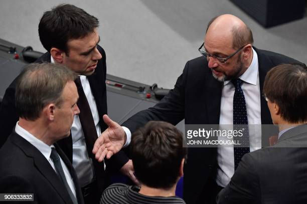Martin Schulz leader of Germany's social democratic SPD party speaks to party colleagues Nils Schmid Thomas Oppermann and Karl Lauterbach on the...