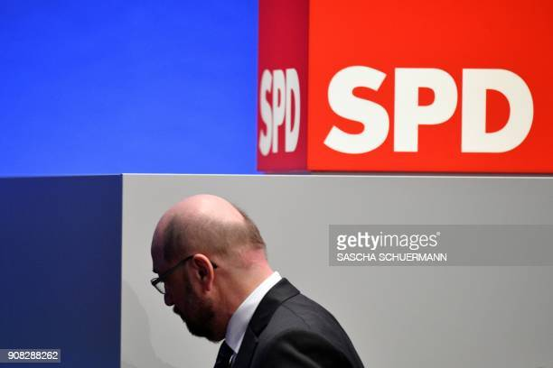 Martin Schulz leader of Germany's social democratic SPD party walks past a logo of the party during an extraordinary SPD party congress in Bonn...