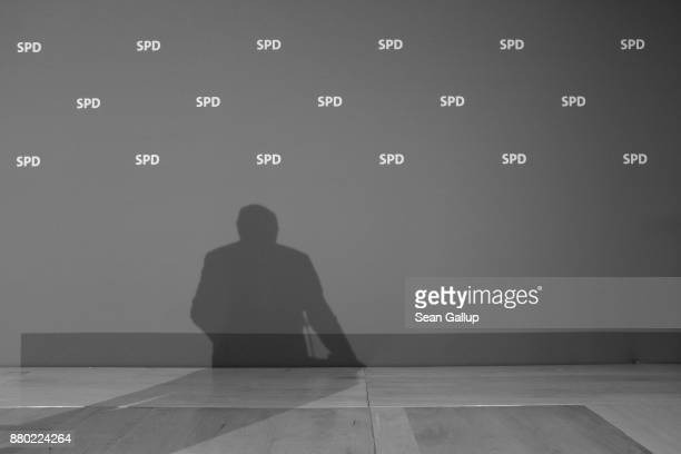 Martin Schulz leader of the German Social Democrats casts a shadow as he speaks to the media following a meeting of the SPD leadership on November 27...