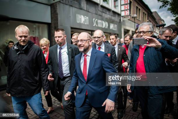 Martin Schulz leader of the German Social Democrats walks during his SPD campaign prior state elections in North RhineWestphalia on May 12 2017 in...