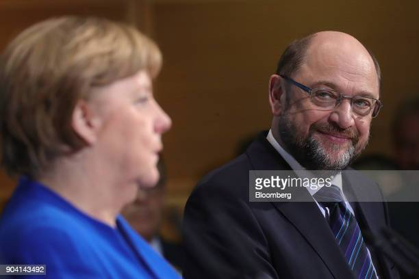 Martin Schulz leader of the Social Democrat Party right looks towards Angela Merkel Germany's chancellor during a news conference following overnight...