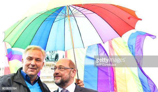 Martin Schulz leader of the social democratic SPD party and candidate for chancellor and Berlin's former mayor Klaus Wowereit attend a rally of gays...