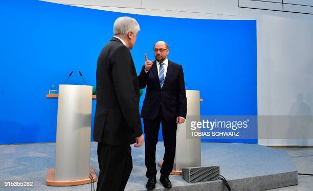 Martin Schulz leader of the social democratic SPD party gestures towards Horst Seehofer leader of the conservative Christian Social Union at the end...