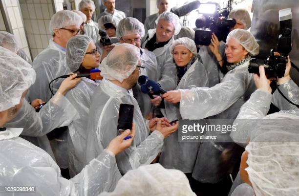 Martin Schulz leading candidate of the SPD party for the general elections talks to journalists during a visit to a fish smokehouse together during...
