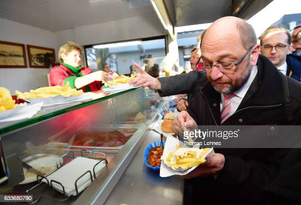 Martin Schulz newlynominated lead candidate for the German Social Democrats in German federal elections eats chips and sausages at the city center...