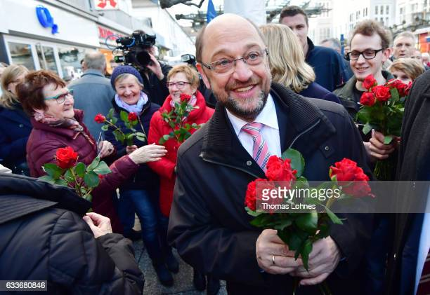 Martin Schulz newlynominated lead candidate for the German Social Democrats in German federal elections walks through the city center talks to people...