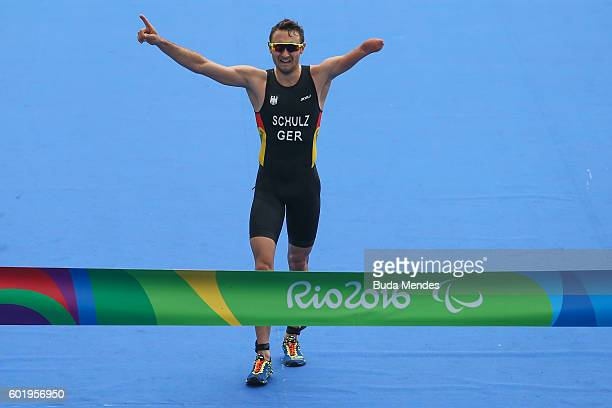 Martin Schulz of Germany celebrates as he approaches the finish line to win the men's triathlon PT14 at Fort Copacabana during day 3 of the Rio 2016...