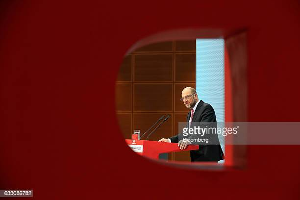 Martin Schulz the Social Democrat Party candidate for German Chancellor is seen through the SPD logo while speaking during a news conference at the...
