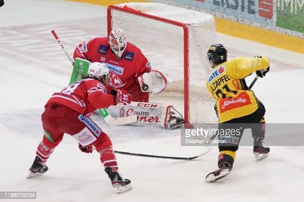 Martin Schumnig of Klagenfurt Lars Haugen of Klagenfurt and Riley Holzapfel of Vienna during the Vienna Capitals v EC KAC Erste Bank Eishockey Liga...