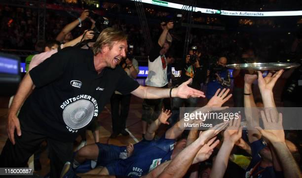 Martin Schwalb head coach of Hamburg lifts the trophy after the Toyota Handball Bundesliga match between HSV Hamburg and TBV Lemgo at the o2 World...