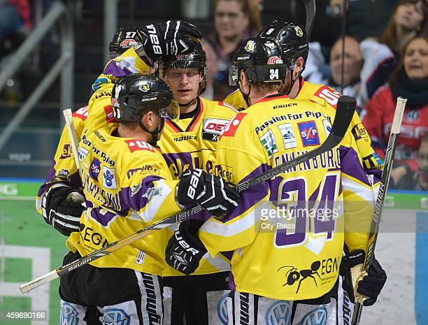 Martin Schymainski, Daniel Pietta, Kyle Sonnenburg of Krefeld Pinguine celebrate after scoring the 3:3 during the game between Eisbaeren Berlin and...