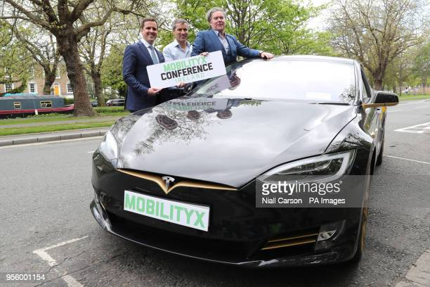 Martin Shanahan CEO of Industrial Development Authority Philip McNamara VP of Voxpro and Dan Kiely CEO of Voxpro with a Tesla Model S car at a launch...