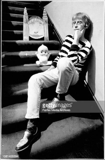 Martin Sharp artist with a Kewpie Doll money Box prize from Luna Park from his collectionPortrait of Luna Park by a young friend Joel May 25 1987