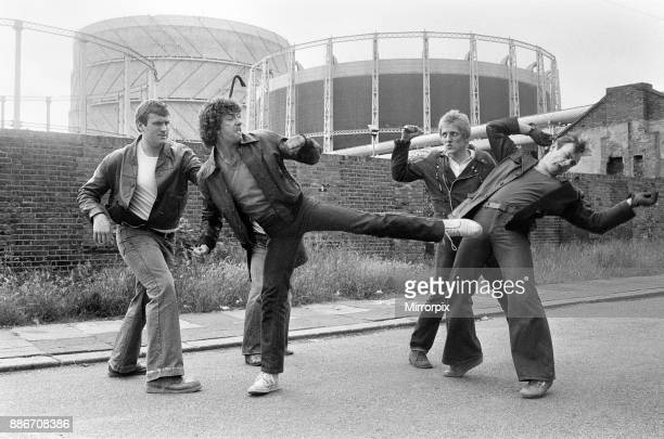 Martin Shaw and Lewis Collins wrestling with the bad guys on the set of the television Detective series The Professionals June 1979