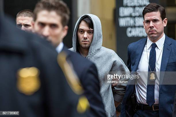 Martin Shkreli CEO of Turing Pharmaceutical is brought out of 26 Federal Plaza by law enforcement officials after being arrested for securities fraud...