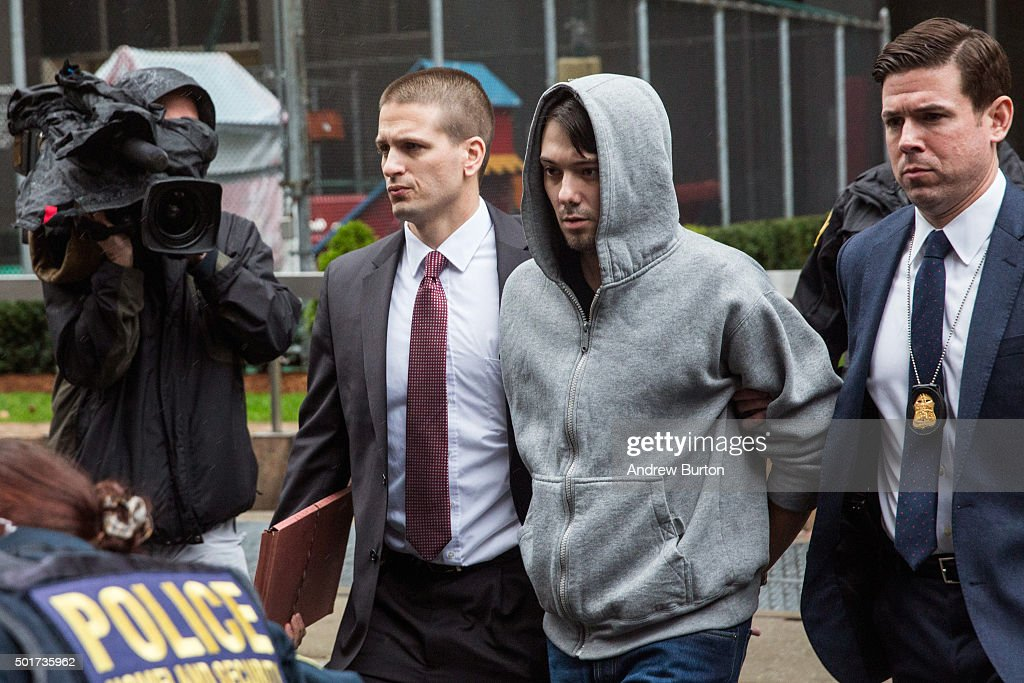 Martin Shkreli (2nd R), CEO of Turing Pharmaceutical, is brought out of 26 Federal Plaza by law enforcement officials after being arrested for securities fraud on December 17, 2015 in New York City. Shkreli gained notoriety earlier this year for raising the price of Daraprim, a medicine used to treat the parasitic condition of toxoplasmosis, from $13.50 to $750 though the arrest that happened early this morning does not involve that price hike.