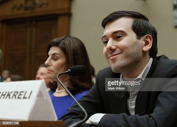 Martin Shkreli former CEO of Turing Pharmaceuticals LLC smiles while flanked by Nancy Retzlaff chief commercial officer for Turing Pharmaceuticals...