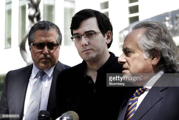 Martin Shkreli former chief executive officer of Turing Pharmaceuticals AG center listens while his attorney Benjamin Brafman right speak to members...