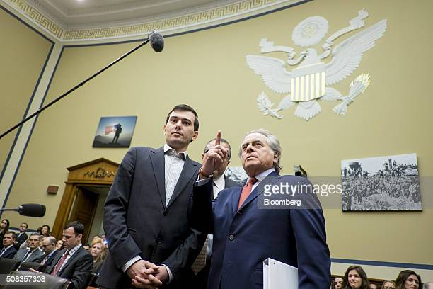 Martin Shkreli former chief executive officer of Turing Pharmaceuticals LLC left confers with attorney Benjamin Brafman right before the start a...