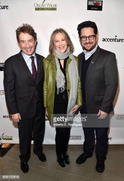 Martin Short Catherine O'Hara and JJ Abrams attend the Oscar Wilde Awards 2018 at Bad Robot on March 1 2018 in Santa Monica California
