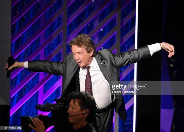 Martin Short speaks onstage at the 18th Annual AARP The Magazine's Movies For Grownups Awards at the Beverly Wilshire Four Seasons Hotel on February...