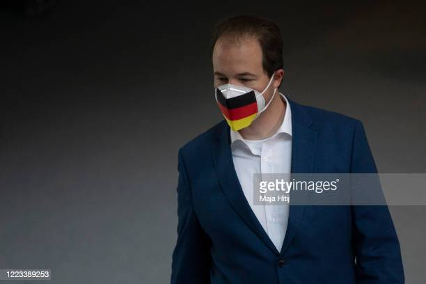 Martin Sichert AfD wears protective face mask with a German flag on it as he attends a session of the Bundestag during the coronavirus crisis on May...