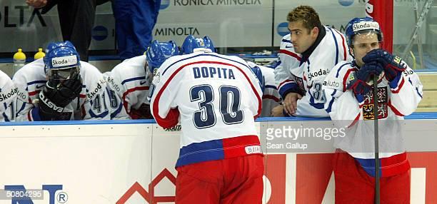 Martin Skoula Jiri Dopita Roman Cechmanek and David Vyborny of the Czech Republic mourn their 32 loss in overtime to the USA in the teams'...