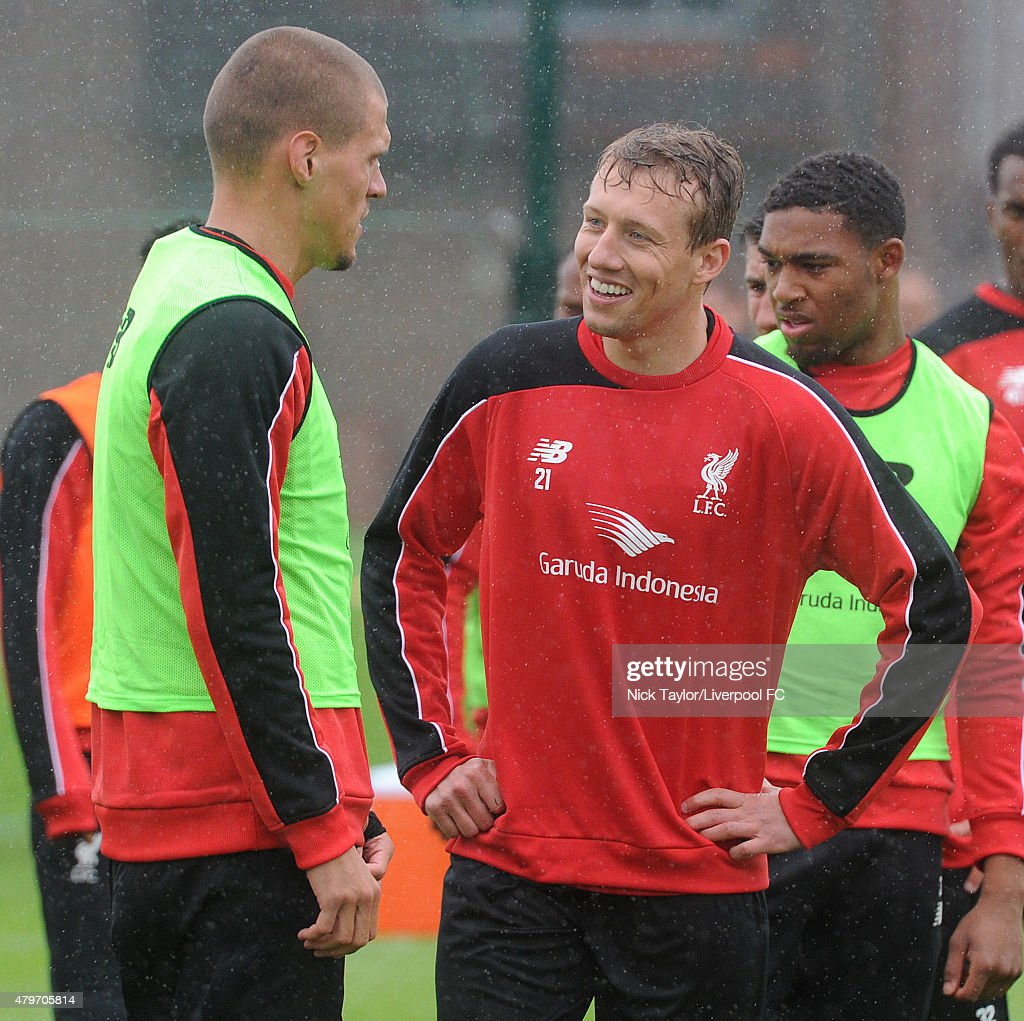 Martin Skrtel and Lucas Leiva during the warm up as Liverpool players return for pre-season training at Melwood Training Ground on July 6, 2015 in Liverpool, England.
