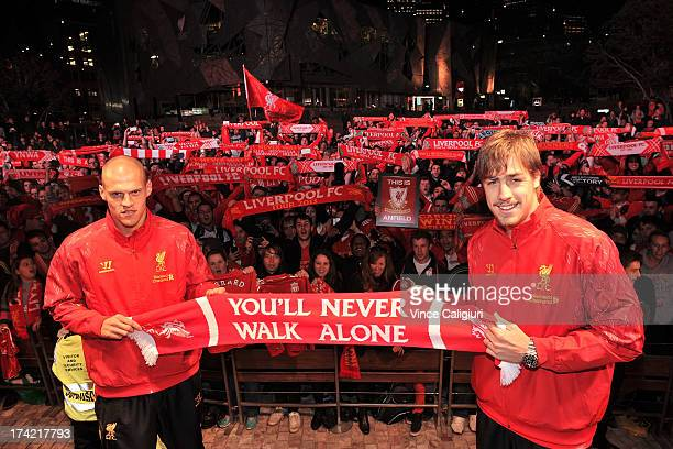 Martin Skrtel and Sebastian Coates of Liverpool FC pose for a photo in front of fans during a Liverpool FC player appearance at Federation Square on...