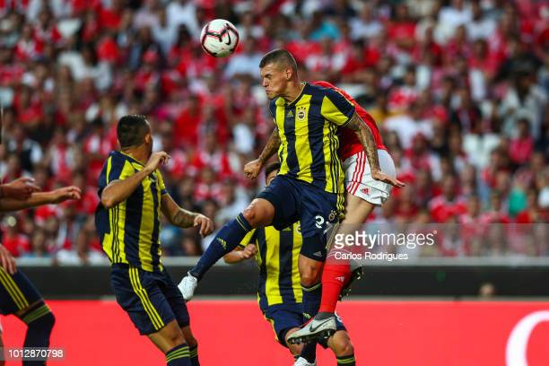 Martin Skrtel of Fenerbache SK heads the ball away during the match between SL Benfica and Fenerbache SK for UEFA Champions League Qualifier at...