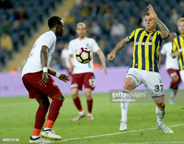 Martin Skrtel of Fenerbahce in action against Dame Ndoye of Trabzonspor during the Turkish Spor Toto Super Lig soccer match between Fenerbahce and...