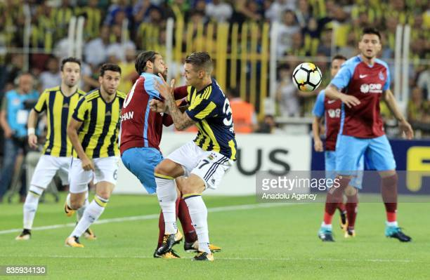Martin Skrtel of Fenerbahce in action against Olcay Sahan of Trabzonspor during Turkish Super Lig soccer match between Fenerbahce and Trabzonspor at...