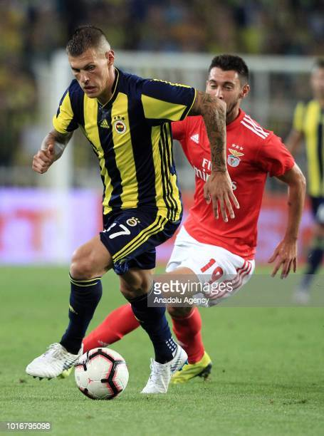 Martin Skrtel of Fenerbahce vies with Facundo Ferreira of Benfica during UEFA Champions League third qualifying round's second leg match between...