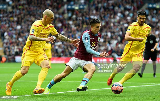 Martin Skrtel of Liverpool and Emre Can of Liverpool marshall Jack Grealish of Aston Villa during the FA Cup Semi Final between Aston Villa and...