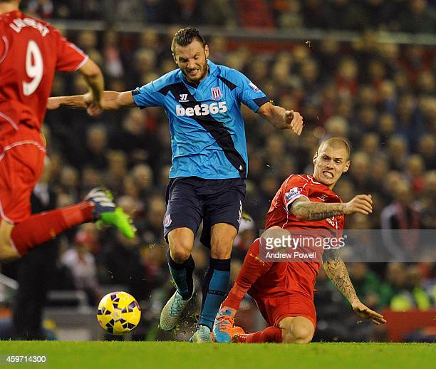 Martin Skrtel of Liverpool and Erik Pieters of Stoke City compete during the Barclays Premier Leauge match between Liverpool and Stoke City at...